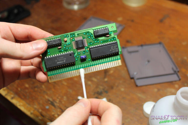 Cleaning NES Game Pins with Alcohol
